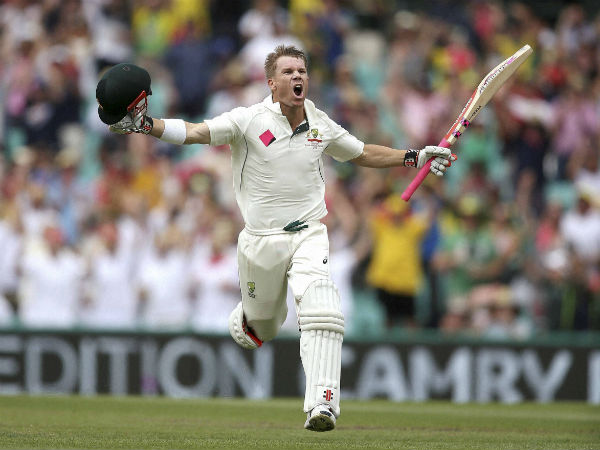 David Warner raises his arms to celebrate making 100 runs against Pakistan during their cricket test match in Sydney, Australia, on January 3, 2017.
