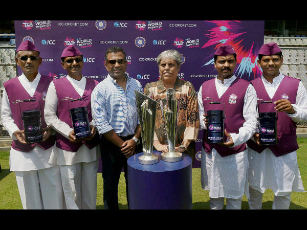 Mumbai Dabbawalas along with former Indian cricketers Sameer Dighe and Diana Edulji pose for a photo during a promotional event ahead of the ICC WT20 in Mumbai.