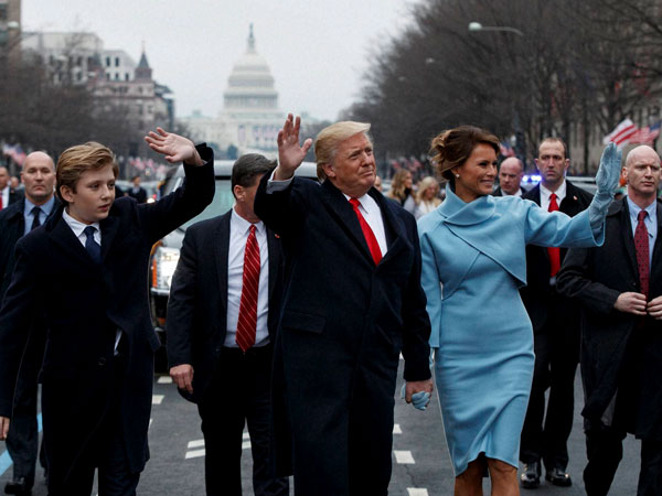 President Donald Trump and first lady Melania Trump walk along the Inauguration Day parade route after being sworn in as the 45th President of the United States.