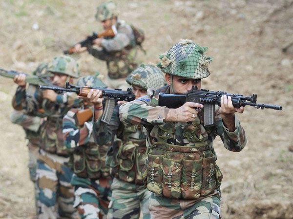 Indian army soldiers patrol near the Line of Control in Pallanwal sector about 70 km from Jammu on Tuesday.