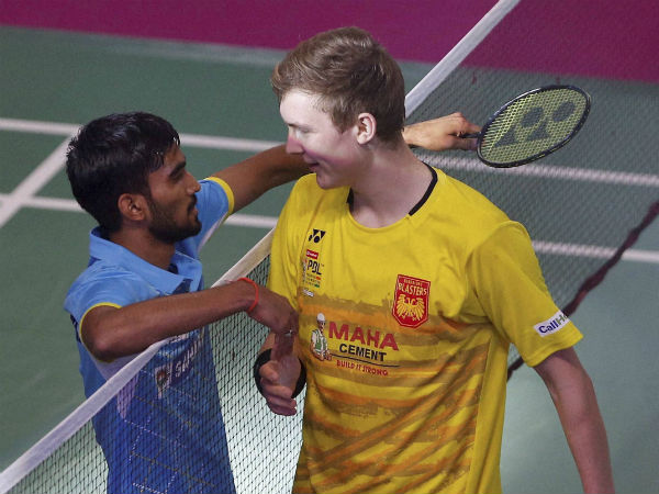 Kidambi Srikanth of Awadhe Warriors after his win shakes hands with Danish badminton player Viktor Axelsen of Bengaluru Blasters during the men's singles of Premier Badminton League (PBL) in Bengaluru on Monday. Srikanth won the match 11-9, 11-9.