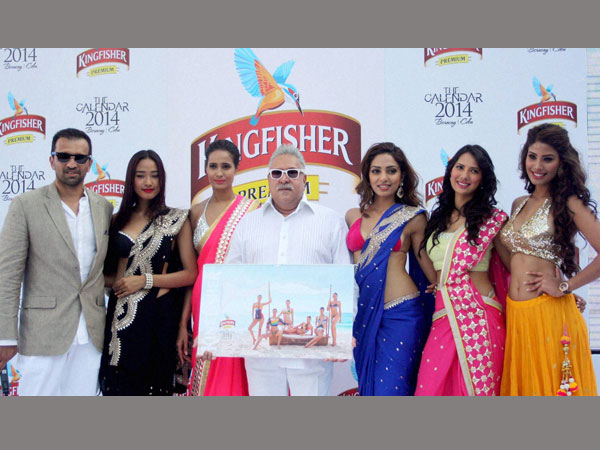 File photo of Vijay Mallya, Chairman of UB Group with models during the launch of Kingfisher Calendar 2014 at Kingfisher House near Alibaug, Maharashtra.