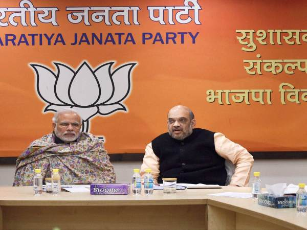 Prime Minister Narendra Modi, BJP President Amit Shah, H during the meeting for Manipur state elections at BJP headquarters in New Delhi.