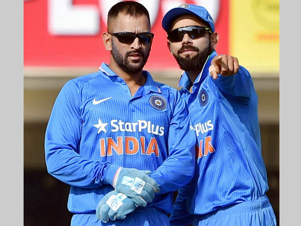 Virat Kohli (right) took over as India captain from MS Dhoni (left)
