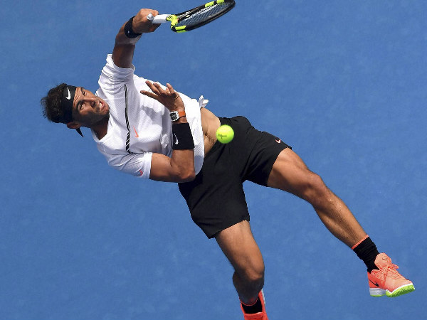 Rafael Nadal plays a shot to Germany's Florian Mayer during their first round match at the Australian Open