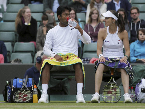 File photo: Leander Paes (left) and Martina Hingis