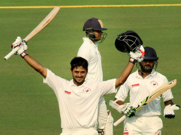 Gujarat batsman Priyank Panchal celebrates his century as Parthiv Patel looks on during the Ranji Trophy semifinal against Jharkhand at VCA stadium in Nagpur
