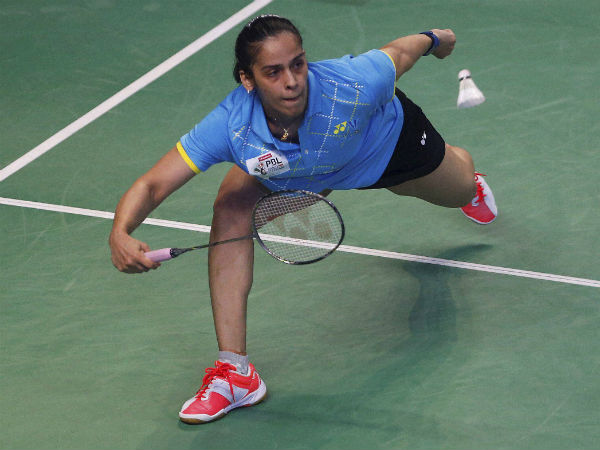 Saina Nehwal of Awadhe Warriors plays against Hong Kong's Cheung Ngan Yi of Bengaluru Blasters during the women's singles of Premier Badminton League (PBL) in Bengaluru on Monday. Nehwal won the match 9-11, 11-5, 11-3.