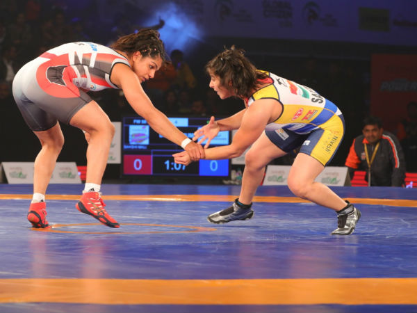 Sakshi Malik (left) and Saritha in action during their PWL bout on Friday