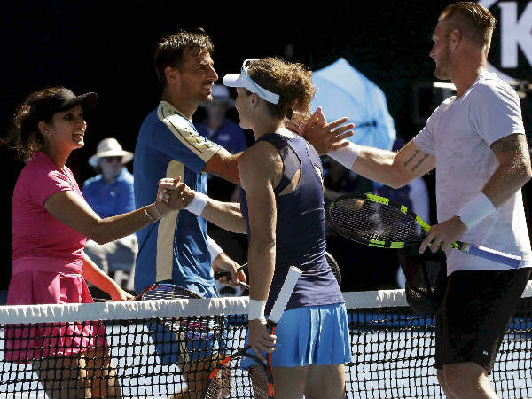 Sania Mirza (left), Ivan Dodig, (2nd left) are congratulated by Samantha Stosur (3rd left) and Sam Groth after their Australian Open semi-final win.
