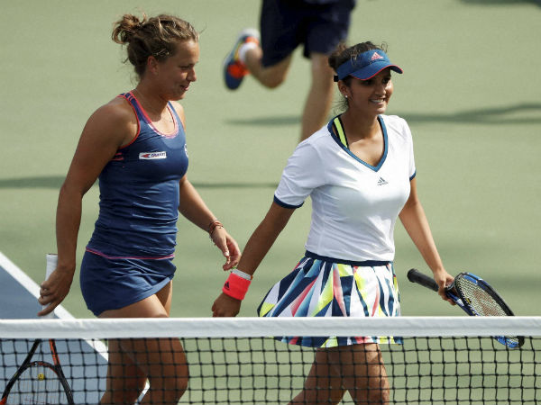 Sania Mirza, right, and doubles partner Barbora Strycova, of the Czech Republic.