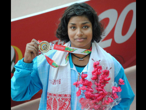 Swimmer Sayani Ghosh with her Gold medal after final round of women 400M Medley event during the 12th South Asian Games in Guwahati.