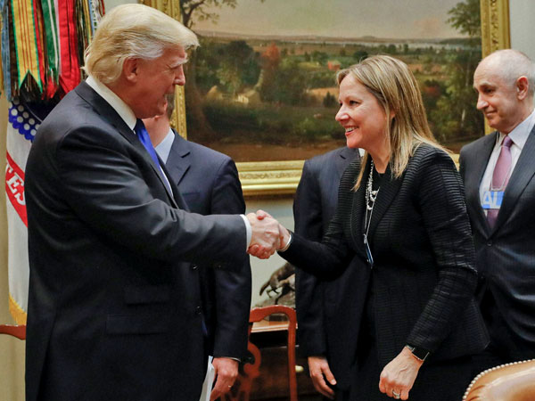 President Donald Trump greets GM CEO Mary Barra as he hosts a breakfast with automobile leaders in the Roosevelt Room of the White House in Washington.