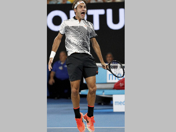 Roger Federer jumps up to celebrate his win over Kei Nishikori