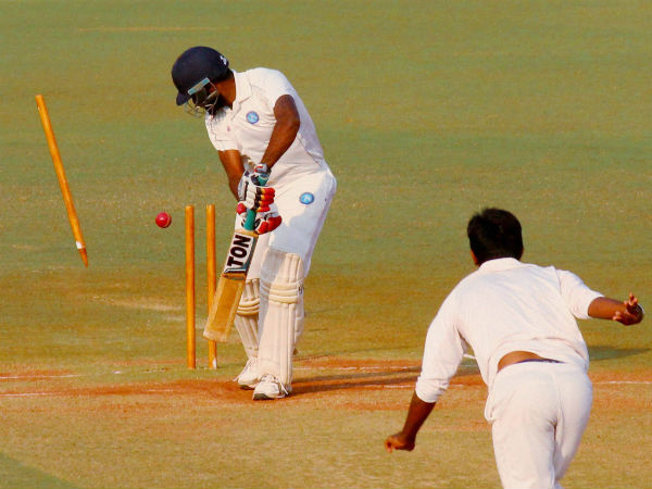 Gujarat bowler Jaspreet Bumrah bowls out Jharkhand batsman Rahul Shukla during the fourth day of Ranji Trophy semifinal cricket match at VCA stadium in Nagpur