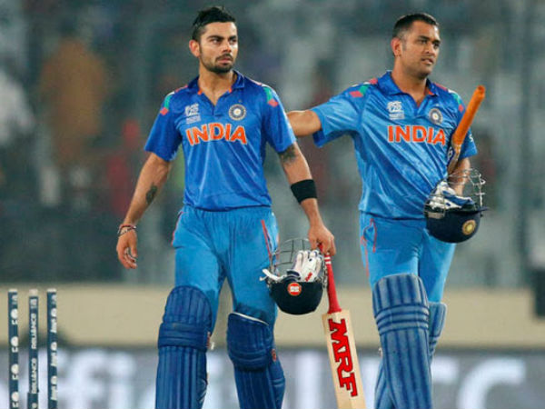 Dhoni (right) and Kohli during a match