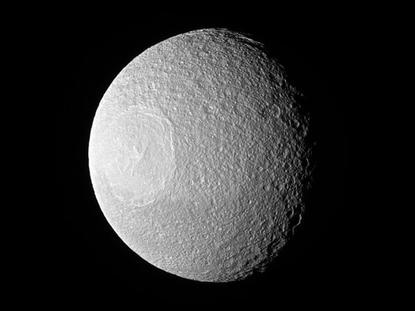 Saturn's Moon Tethys Looks like a Giant Eyeball Staring off into Space