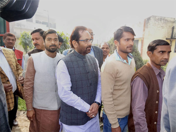 Mukhtar Abbas Naqvi stands in line to cast his vote