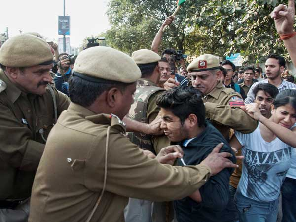 Police detain ABVP students after their clash with All India Students Association members at Delhi University north campus in New Delhi