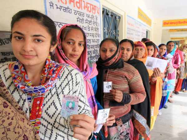 Women voters wait in a long queue at a polling station to cast their votes for Punjab Assembly elections at Badal village in Muktsar.