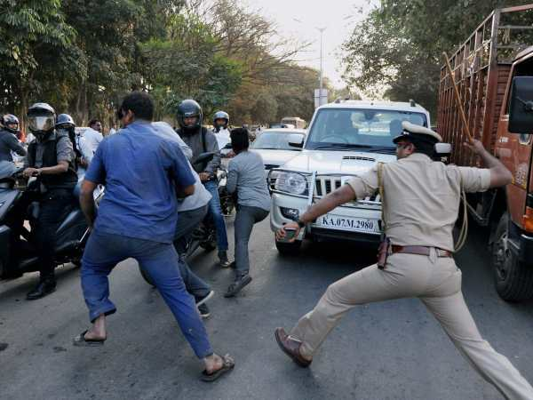 Police baton charges an AIADMK supporter in Bengaluru in this photograph taken on February 16, 2017.