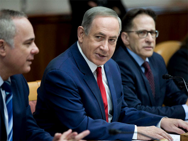 Israeli Prime Minister Benjamin Netanyahu, center, attends the weekly cabinet meeting at his office in Jerusalem, Israel, Sunday, Jan. 29, 2017.