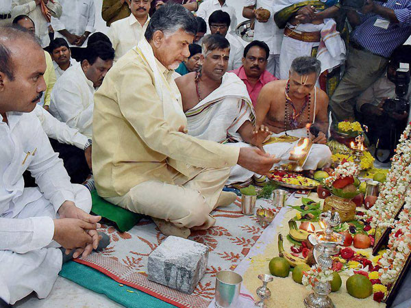 AP Chief Minister N Chandrababu Naidu performs rituals after entering into his new office chamber in the Government's Transitional Headquarters at Velagapudi in the Amaravati capital region, Andhra Pradesh.