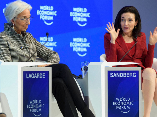 Chief Operating Officer of Facebook Sheryl Sandberg, right, speaks next to Christine Lagarde, Managing Director of the International Monetary Fund, IMF, during a plenary session in the Congress Hall during the 47th annual meeting of the World Economic Forum, WEF, in Davos, Switzerland.