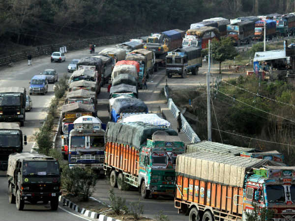 Vehicles move toward Kashmir after partial restoration of Jammu-Srinagar National Highway after weather conditions improved across Jammu and Kashmir, in Jammu.