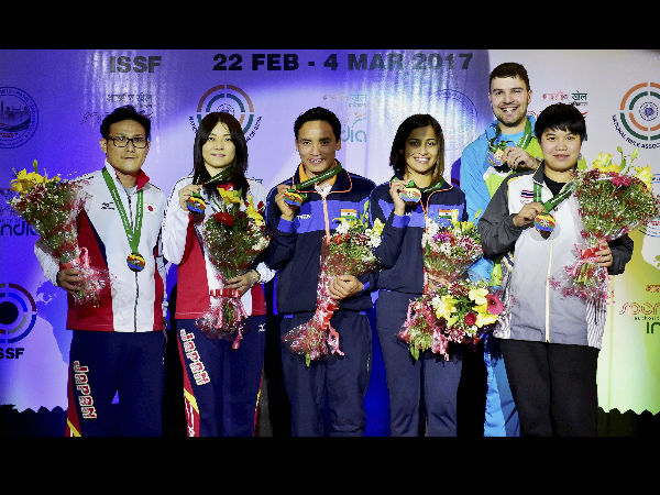 India's Heena Sidhu and Jitu Rai with silver and bronze medal winners after winning mixed team 10m Air Pistol event of the ISSF World Cup in New Delhi.
