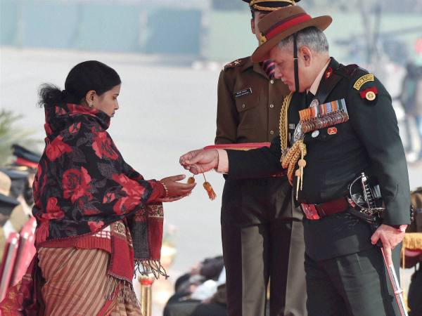 Army Chief Gen Bipin Rawat honours Siachen braveheart Lance Naik Hanamanthappa Koppad's widow Mahadevi during the Army Day parade in New Delhi in this photograph taken on January 15.