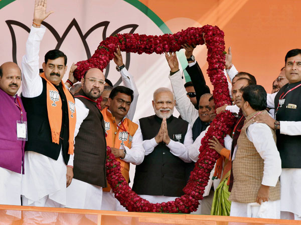 Prime Minister Narendra Modi along with other leaders being garlanded during the BJP's Parivartan Sankalp Rally in Ghaziabad on Wednesday ahead of the UP Assembly polls.