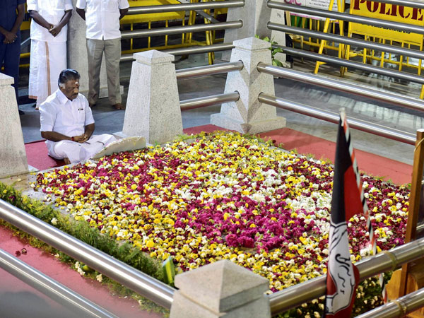 Tamil Nadu Chief Minister O Panneerselvam sitting in a meditation in front of late J Jayalalithaa's burial site at the Marina Beach in Chennai.