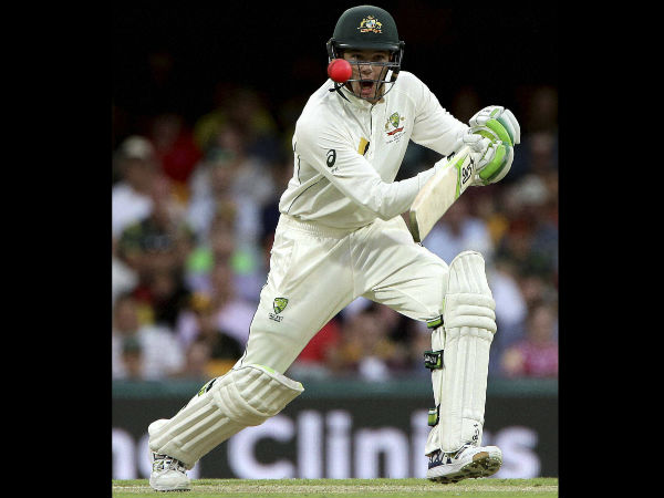 Australian batsman Peter Handscomb reacts as watches the ball during play