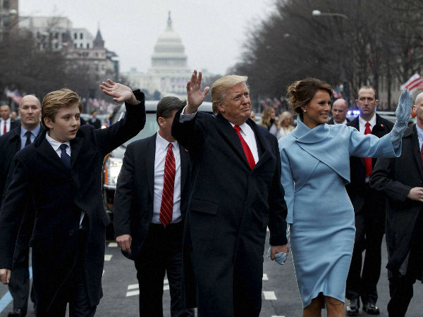 President Donald Trump and first lady Melania Trump walk along the Inauguration Day parade route after being sworn in as the 45th President of the United States, Friday, Jan. 20, 2017, in Washington.