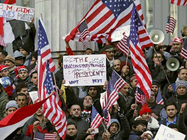 Muslims and Yemenis gather with their supporters on the steps of Brooklyn's Borough Hall, during a protest against President Donald Trump's temporary travel ban on citizens from seven predominantly Muslim countries.