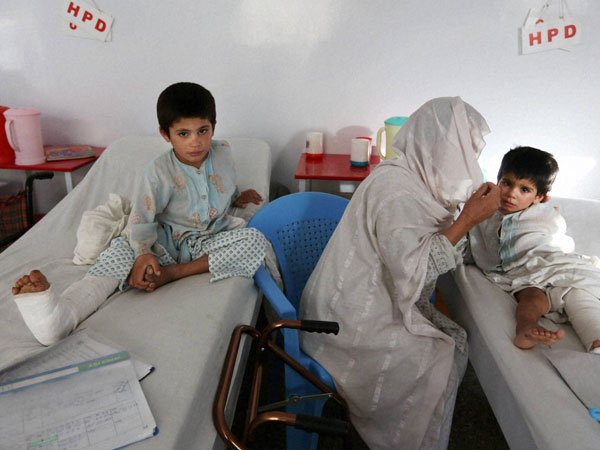 Afghan child war victims receive treatment at the Emergency Hospital in Kabul, Afghanistan, Monday, July 25, 2016. The United Nations mission in Afghanistan says the number of children killed or wounded in the country's conflict has surged in the first half of this year, compared to last year.