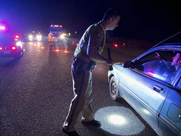 California Highway Patrol officer Ken Weckman directs traffic as residents evacuate Marysville, California.