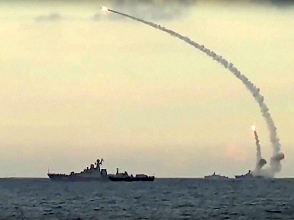 In this photo from Russian Defense Ministry official website, Russian navy ships launch cruise missiles from the Caspian Sea, according to information released by the Defense Ministry.