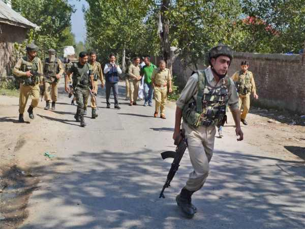 Insurgents attack Kashmir minister's house, two cops hurt; weapons decamped