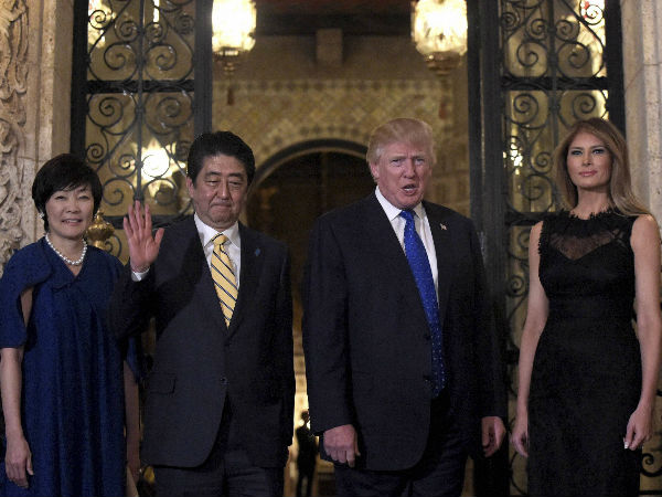 President Donald Trump, second from right, and first lady Melania Trump, right, stop to pose for a photo with Japanese Prime Minister Shinzo Abe, second from left, and his wife Akie Abe, left, before they have dinner at Mar-a-Lago in Palm Beach, Fla.,