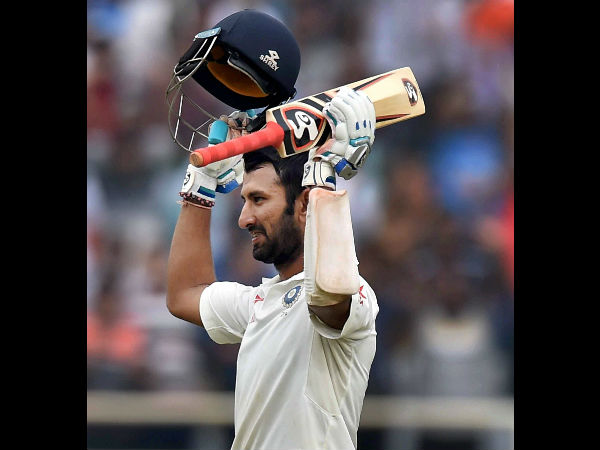 Pujara raises his bat