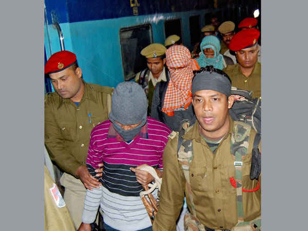 An accused in the Burdwan case being escorted by police