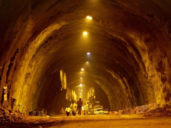 Workers of the Chenani-Nashri tunnel project during the final breakthrough process on Jammu-Srinagar National Highway at Udhampur. Photo credit: PTI