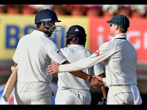 Australian captain Steve Smith congratulating Indian batsman C.Pujara at the end of 3rd day's play.