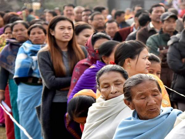 Manipuri people stand in a queue to cast their votes in Thoubal constituency of Manipur during the last phase of state assembly elections. Image form representation only. Photo credit: PTI
