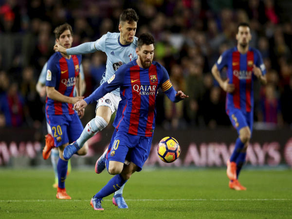 File photo: Lionel Messi (centre) in action for Barcelona