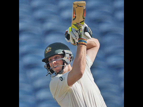 Australian batsman Mitchell Marsh plays a shot during the first Test match played against India in Pune.