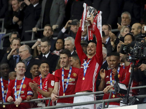 File photo: Manchester United players with EFL Cup trophy