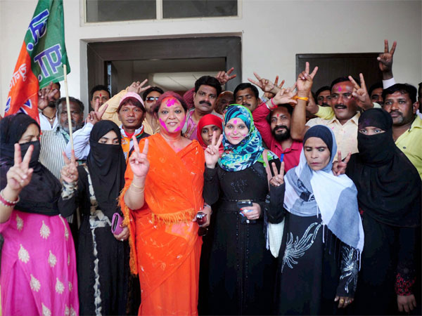 Muslim BJP supporters celebrate the party's victory in the Uttar Pradesh Assembly elections at the party office in Lucknow